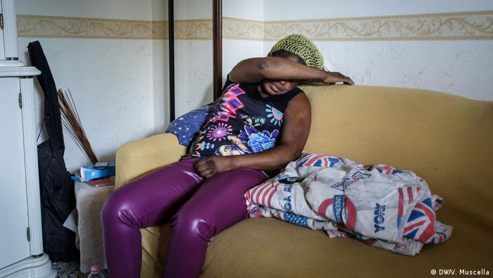 Grace sits on a sofa in a flat in Castel Volturno, Italy (DW/V. Muscella)