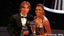 Soccer Football - The Best FIFA Football Awards - Royal Festival Hall, London, Britain - September 24, 2018 Luka Modric and Marta pose with their awards Action Images via Reuters/John Sibley