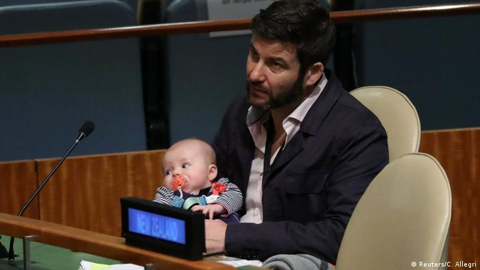 Clarke Gayford with baby Neve watch Jacinda Ardern's address at the UN