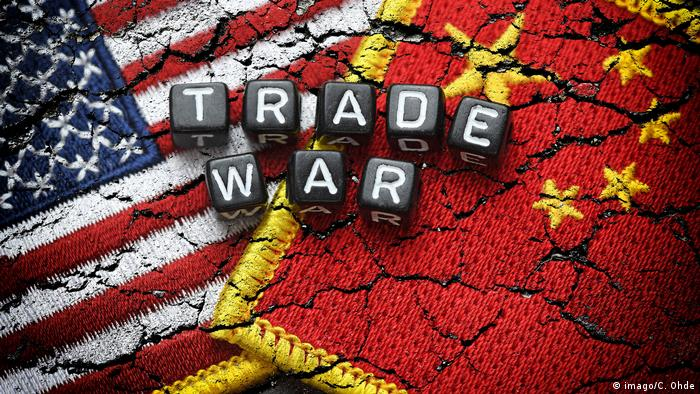 Flags of the US and China with the words Trade War