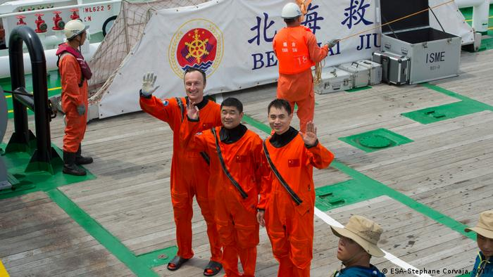 ESA astronaut Matthias Maurer with Chinese colleagues on a ship in China in 2017
