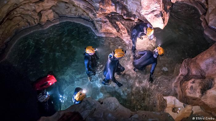 Astronauts from five space agencies around the world underground as part of ESA's CAVES training course