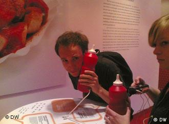 man listening to song through a fake ketchup bottle