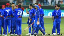 September 26, 2018 - Dubai, United Arab Emirates - Afghanistan cricketers celebrate after the cricket match ended in a tie during the Asia Cup 2018 cricket match between India and Afghanistan at Dubai International cricket stadium,Dubai, United Arab Emirates. 09-25-2018 India v Afghanistan - Asia Cup 2018 PUBLICATIONxINxGERxSUIxAUTxONLY - ZUMAn230 20180926_zaa_n230_011 Copyright: xTharakaxBasnayakax