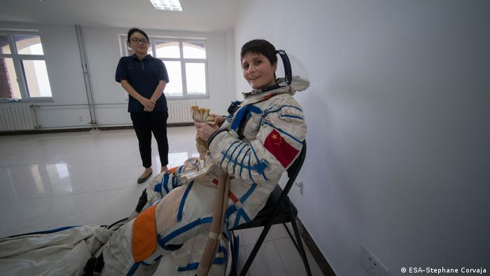 ESA astronaut Samantha Cristoforetti in a Chinese pressure suit with a female Chinese colleague next to her (ESA–Stephane Corvaja)