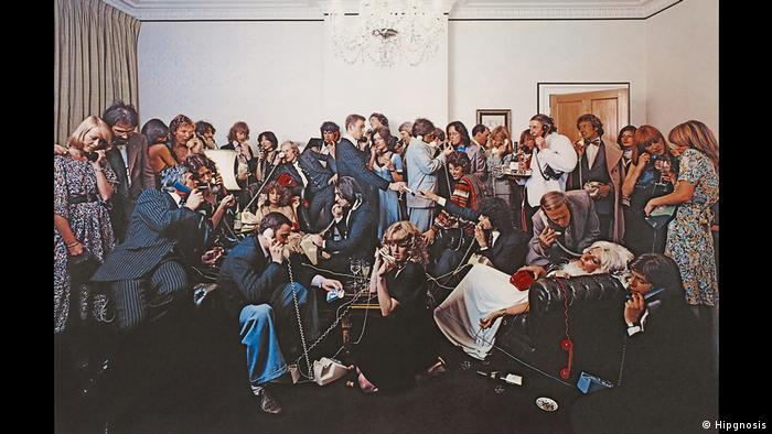 Album Cover 10cc, How Dare You (Hipgnosis) a group of people on interconnected phones (1976)