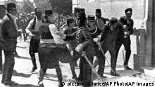 The young assassin whose shots set off World War I is taken by police to the police station in Sarajevo, Yugoslavia, June 28, 1914. A Bosnian Serb nationalist, tubercular, 19-year-old Gavrilo Princip, right, was captured after a scuffle on the spot at which he killed the Archduke Franz Ferdinand, heir to the Austrian-Hungarina throne, and his wife. Spared from death by his youth, Princip died four years later in prison. (AP Photo)  
