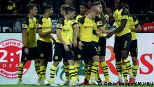 DORTMUND, GERMANY - SEPTEMBER 26: Team members of Dortmund celebrate the opening goal during the Bundesliga match between Borussia Dortmund and 1. FC Nuernberg at Signal Iduna Park on September 26, 2018 in Dortmund, Germany. (Photo by Maja Hitij/Bongarts/Getty Images)