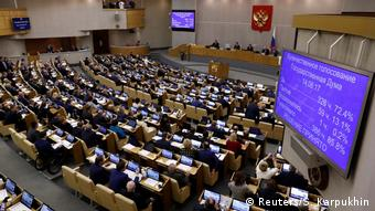 An electronic screen shows the results of the final vote on the pension reform bill at the State Duma, Russia's lower house of parliament