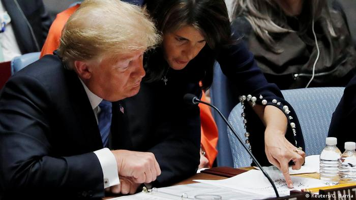 US Ambassador to the United Nations Nikki Haley points at her handwritten notes for US President Donald Trump as he chairs a UN Security Council meeting on September 26, 2018.