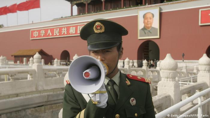 Chinese policeman with a megaphone