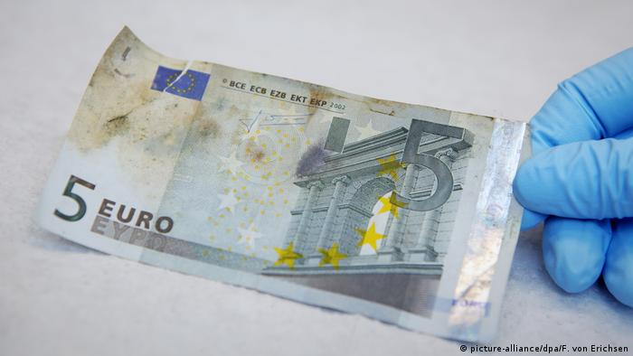A damaged five Euro bank note.