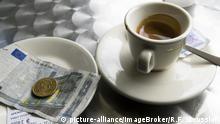 Espresso, mit Rechnung und Wechselgeld