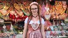 An American's First (Real) Oktoberfest. I bought a Lebkuchenherz or gingerbread heart cookie to wear.