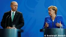 German Chancellor Angela Merkel and Turkish President Tayyip Erdogan address a news conference at the chancellery in Berlin, Germany, September 28, 2018. REUTERS/Fabrizio Bensch