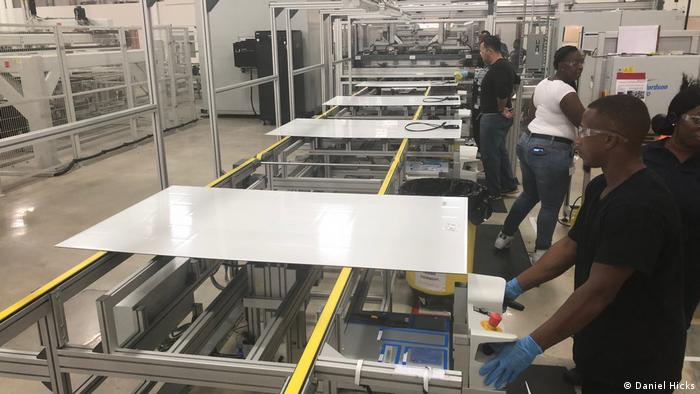 Employees at SolarTech Universal in Riviera Beach, Florida, making solar panels