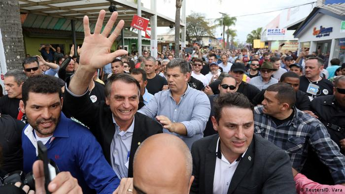 Brazil's Bolsonaro is greeted by supporters during an agribusiness fair in Rio Grande do Sul state
