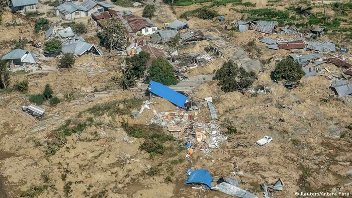 Rooftoops of destroyed houses visible above the mud in Sulawesi (Reuters/Antara Foto)