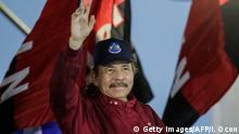 Nicaraguan President Daniel Ortega waves to his supporters during a march in support of his government in Managua on September 29, 2018. - Supporters of Nicaraguan President Daniel Ortega marched Saturday in the framework of opposition protests demanding his resignation. (Photo by INTI OCON / AFP) (Photo credit should read INTI OCON/AFP/Getty Images)