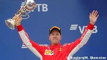 Formula One F1 - Russian Grand Prix - Sochi, Russia - September 30, 2018 Third placed Ferrari's Sebastian Vettel celebrates with a trophy after the race REUTERS/Maxim Shemetov
