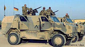 German troops in Afghanistan on an armored vehicle