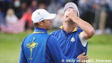 PARIS, FRANCE - SEPTEMBER 30: Jon Rahm of Europe celebrates winning his match with caddie Adam Hayes during singles matches of the 2018 Ryder Cup at Le Golf National on September 30, 2018 in Paris, France. (Photo by Christian Petersen/Getty Images)