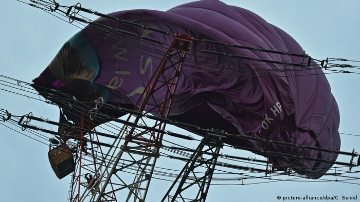 A hot air balloon stuck on a powerline after it crashed in the northwestern German town of Bottrop