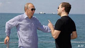 Russian President Dmitry Medvedev and Premier Vladimir Putin speak in Sochi last summer.