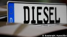 FILE PHOTO: Protests against Germany's Dieselgate in front of Germany's Federal Ministry of Transport and Digital Infrastructure where ministers and car executives hold a meeting to agree ways to cut inner-city pollution to try to stave off bans on diesel cars and restore the tarnished reputation of the country's auto industry in Berlin, Germany, August 2, 2017. REUTERS/Hannibal Hanschke/File Photo