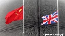 Visitors walk past the Chinese and UK flags fluttering at half-mast to mourn for the victims of the Qinghai Yushu 7.1-magnitude earthquake in front of the UK Pavilion in the Expo site in Shanghai, China, 21 April 2010. China on Wednesday (21 April 2010) started a day of mourning for the victims of the 7.1-magnitude earthquake in Yushu county in northwest Chinas Qinghai province. Flags are ordered to be flown at half-mast across the country and public entertainment suspended. Death toll in the quake has risen to 2,183. 84 others are missing and over 12,000 people were injured. |