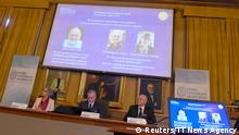 The Nobel Prize laureates for physics 2018 Arthur Ashkin of the United States, Gerard Mourou of France and Donna Strickland of Canada are announced at the Royal Swedish Academy of Sciences in Stockholm, Sweden, October 2, 2018. Hanna Franzen/TT News Agency/via REUTERS ATTENTION EDITORS - THIS IMAGE WAS PROVIDED BY A THIRD PARTY. SWEDEN OUT. NO COMMERCIAL OR EDITORIAL SALES IN SWEDEN.