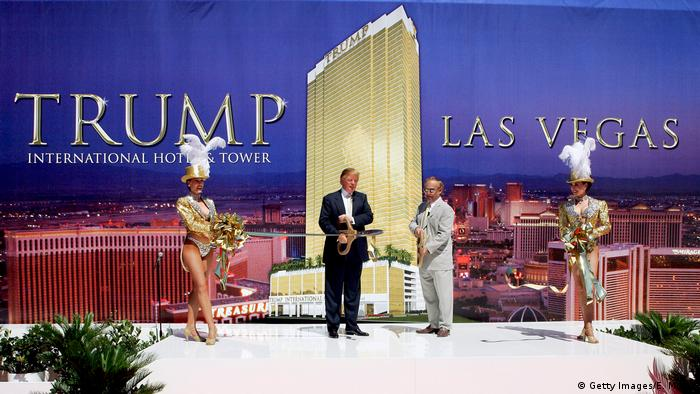 Donald Trump stands onstage at one of his hotel properties (Getty Images/E. Miller)