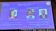 03.10.2018 Pictures of the 2018 Nobel Prize laureates for chemistry: Frances H. Arnold of the United States, George P. Smith of the United States and Gregory P. Winter of Britain are displayed on a screen during the announcement at the Royal Swedish Academy of Sciences, in Stockholm, Sweden, October 3, 2018. Jonas Ekstromer/TT News Agency/via REUTERS ATTENTION EDITORS - THIS IMAGE WAS PROVIDED BY A THIRD PARTY. SWEDEN OUT. NO COMMERCIAL OR EDITORIAL SALES IN SWEDEN.