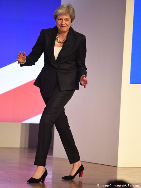 The Prime Minister Theresa May dances onto the stage before delivering her keynote speech on the final day of the 2018 Conservative Party Conference in Birmingham.