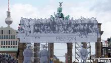 03.10.2018+++Berlin, Deutschland+++ People attend German Unification Day celebrations at the Brandenburg Gate in Berlin, Germany, October 3, 2018. REUTERS/Fabrizio Bensch