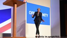 03/10/2018. TOPSHOT - Britain's Prime Minister Theresa May dances a few steps as she takes the stage to give her keynote address on the fourth and final day of the Conservative Party Conference 2018 at the International Convention Centre in Birmingham, central England, on October 3, 2018. (Photo by Oli SCARFF / AFP) (Photo credit should read OLI SCARFF/AFP/Getty Images)