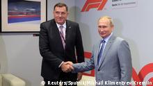 Russian President Vladimir Putin shakes hands with President of the Republika Srpska Milorad Dodik in Sochi, Russia September 30, 2018. Sputnik/Mikhail Klimentyev/Kremlin via REUTERS ATTENTION EDITORS - THIS IMAGE WAS PROVIDED BY A THIRD PARTY.