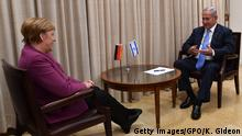 03.10.2018 *** JERUSALEM, ISRAEL - OCTOBER 3: (ISRAEL OUT) In this handout image supplied by the Israeli government press office (GPO), Israeli Prime Minister, Benjamin Netanyahu speaks with German Chancellor, Angela Merkel during a meeting at the Prime Minister's on October 3 , 2018 in Jerusalem, Israel. residence in Jerusalem. (Photo by Kobi Gideon/GPO via Getty Images)