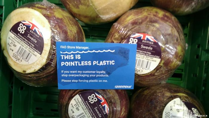 A collection of swedes wrapped in plastic, with a note reading FAO store manager: this is pointless plastic