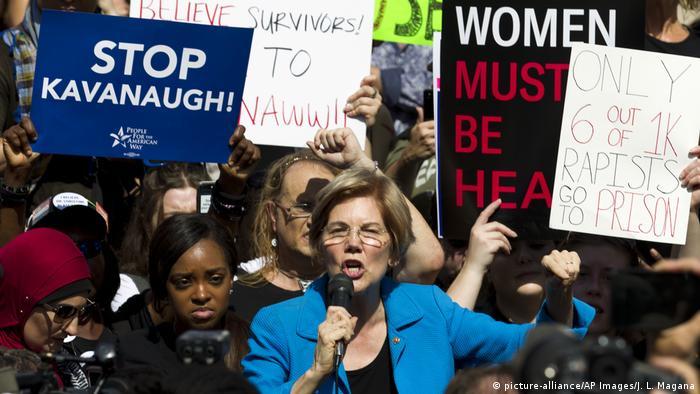 Democrat Senator Elizabeth Warren speaks to demonstrators as they protest against Supreme Court nominee Brett Kavanaugh.