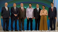 Brazilian presidential candidates pose for a photo before a live, televised debate in Rio de Janeiro, Brazil, Thursday, Oct. 4, 2018, ahead of Oct. 7 general elections. From left are Henrique Meirelles of the Democratic Movement Party, Alvaro Dias of Podemos Party, Ciro Gomes of the Democratic Labor Party, Guilherme Boulos of the Socialism and Liberty Party, Geraldo Alckmin of the Social Democratic Party, Marina Silva of the Sustainability Network Party and Fernando Haddad of the Worker's Party. (AP Photo/Silvia Izquierdo) |
