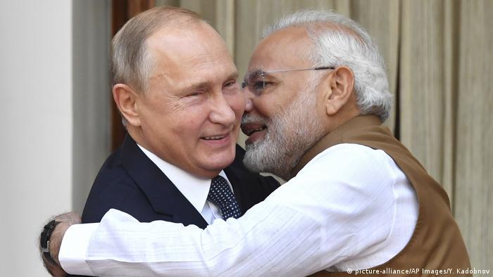 Indian Prime Minister Narendra Modi hugs Russian President Vladimir Putin in New Delhi