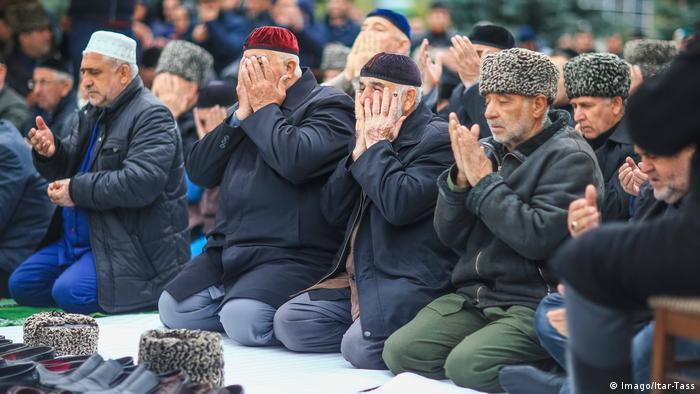 Men praying in Ingushetia