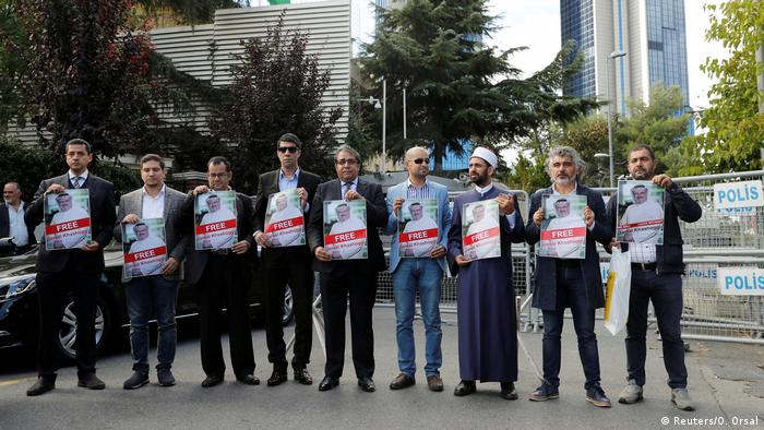 Demonstrators hold pictures of Khashoggi outside the Saudi consulate in Istanbul