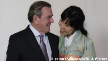 Former German Chancellor Gerhard Schroeder, left, poses with his South Korean wife Kim So-yeon during a reception to celebrate their wedding five months earlier in the hotel Adlon in Berlin Friday, Oct. 5, 2018. (Kai-Uwe Waerner/pool photo via AP) |
