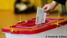 06.10.2018 A woman casts her vote during a general election in Riga, Latvia October 6, 2018. REUTERS/Ints Kalnins