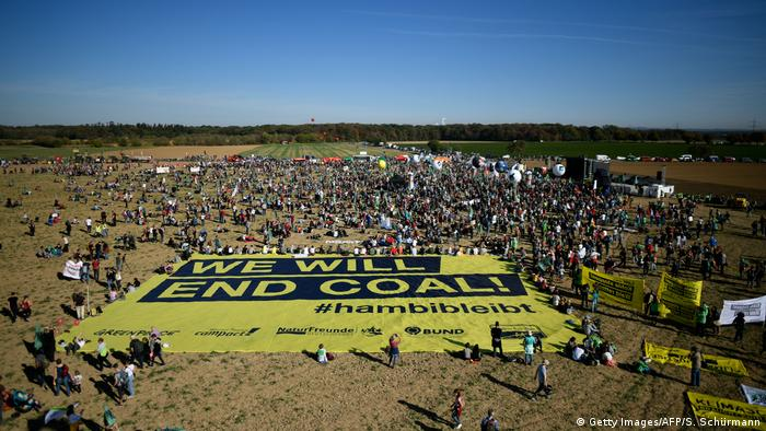 Demonstration at Hambach Forest with banner 'We will end coal!' on the ground. (Getty Images/AFP/S. Schürmann)