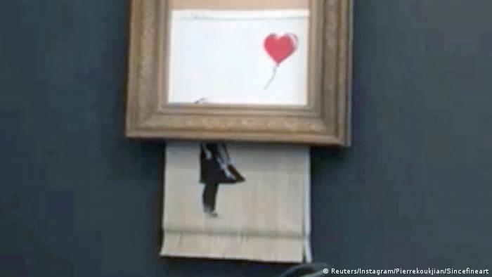 Banksy artwork Girl with Red Balloon shredded during auction at Sotheby's (Reuters/Instagram/Pierrekoukjian/Sincefineart)