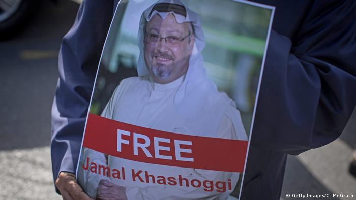 A man holds a poster of Saudi journalist Jamal Khashoggi during a protest