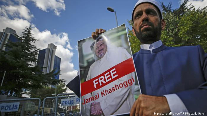 A man holds up a poster calling for the release of missing Saudi writer Jamal Kashoggi